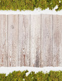 Wooden background with branches of Christmas tree Royalty Free Stock Photos