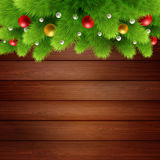 Wooden background with branches of Christmas tree. And baubles Royalty Free Stock Photo