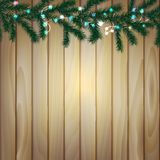 Wooden background with branches of Christmas tree and light bulbs,. Vector illustration Stock Image