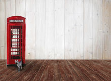 Wooden background with british phone box, tabby cat and copy spa. Nostalgic wooden background with red british phone box, tabby cat and copy space stock photos