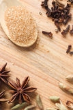 Wooden background with brown sugar crystals Stock Image