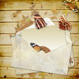 Wooden background with butterflies and envelope wi Royalty Free Stock Photo