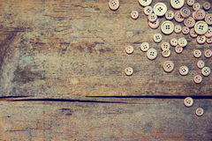 Wooden background with buttons Royalty Free Stock Images