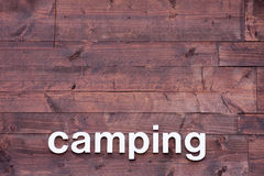 Wooden Background with Camping in White Letters Royalty Free Stock Images