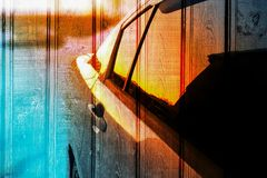 Wooden background and car at sunset, reflected in mirrors. Unique texture, wooden background and car at sunset, reflected in mirrors Stock Photo