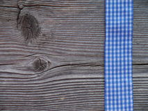 Wooden background with a checked ribbon Stock Photos
