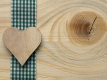 Wooden background with a checked ribbon Royalty Free Stock Photos