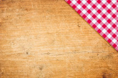 A wooden background with checkered tablecloth Royalty Free Stock Photography