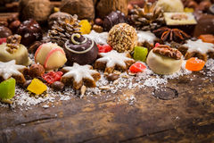 Wooden background with chocolate sweets Royalty Free Stock Photo