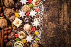 Wooden background with chocolate sweets Stock Photography