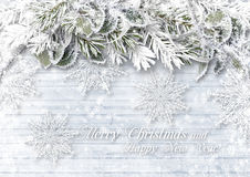 Wooden background with Christmas border and delicate snowflakes. Christmas background with décor elements and place for photos and congratulations Stock Image