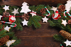 Wooden background with christmas decorations  on fir branches Stock Photography