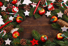 Wooden background with christmas decorations  on fir branches Royalty Free Stock Photo