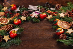 Wooden background with christmas decorations  on fir branches Royalty Free Stock Photography