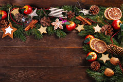 Wooden background with christmas decorations  on fir branches Stock Photos