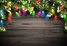 Wooden background with Christmas lights. Wooden background with Christmas garland and fir branches. Vector illustration Royalty Free Stock Photos