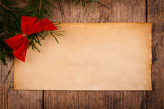 Wooden background with Christmas ornaments and old paper Stock Images