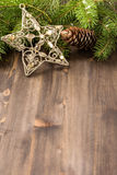 Wooden background with Christmas star and fir tree with copy spa Royalty Free Stock Image