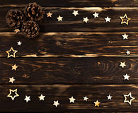 Wooden background with christmas  stars folded on the perimeter Stock Image