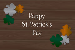 Wooden background and clover on St. Patrick's day. Wooden background. Irish flag clover on St. Patrick's day Royalty Free Stock Photo