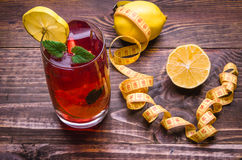 Wooden background about cocktail, centimeter and lemon. Fitness concept with cocktail, centimeter, lemon Stock Photos