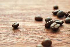 Wooden background and coffee beans. Coffee beans on the background of wood texture Royalty Free Stock Image