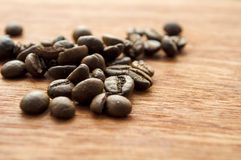 Wooden background and coffee beans. Coffee beans on the background of wood texture Stock Photo
