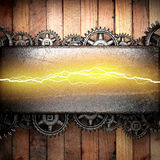 Wooden background with cogwheel gears and electric lightning Stock Images