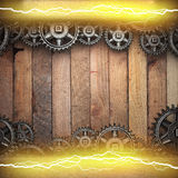 Wooden background with cogwheel gears and electric lightning Royalty Free Stock Photos