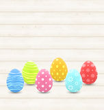 Wooden background with colorful traditional eggs for Easter Stock Photo