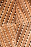 Wooden background concentric rhombs shape. Concentric background, wooden tables positioned in a diamond shape. Brown color. A regular and orderly background Royalty Free Stock Image