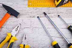 On a wooden background, the construction tools . View from above. stock photos