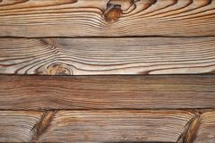 Wooden background, contrast structure of burnt wood with knots, in the form of horizontal boards. Wooden background, contrast structure of burnt wood with knots stock images