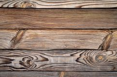 Wooden background, contrast structure of burnt wood with knots, in form of horizontal boards. Wooden background, contrast structure of burnt wood with knots, in royalty free stock image