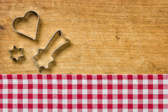 Wooden background with cookie cutters Stock Photography