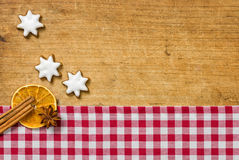 Wooden background with cookies and christmassy spices Stock Image