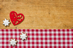 Wooden background with cookies and a felt heart Royalty Free Stock Photo