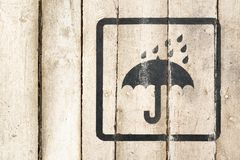 Consignment, carriage signs and symbols. Keep dry icon. Delivery service. Bar, care, night club interior. Wooden background. Country, underground, grunge stock photos