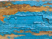 Wooden background with old blue paint. Cracked multi-layered paint stock photos