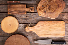 Wooden background with cutting boards Royalty Free Stock Photo