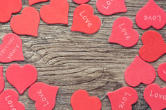 Wooden background of dark color with red hearts. Stock Photography