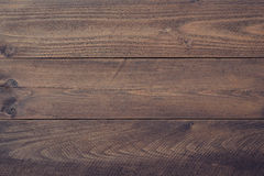 Wooden background. Dark textured wooden boards. May be used as background Stock Photos