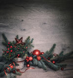 Wooden background with decorated Christmas tree twigs and berrie Royalty Free Stock Photo