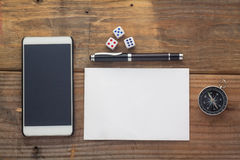 Wooden Background Desk With Paper,dice,compass,smart Phone And Pen. Stock Images