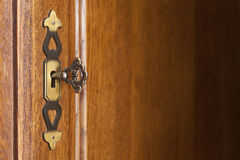 Wooden background with doorplate and key Royalty Free Stock Photo