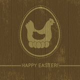 Wooden background with easter eggs and hen Royalty Free Stock Photo