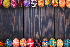 Wooden background with Easter eggs. Stock Photo