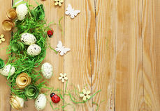 Wooden background with Easter symbols, eggs, butterflies Stock Images