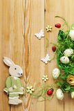 Wooden background with Easter symbols, eggs, butterflies Royalty Free Stock Images