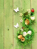Wooden background with Easter symbols, eggs, butterflies Royalty Free Stock Photography